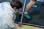 Вимірювання результату на змаганнях зі стрибків у довжину з місця